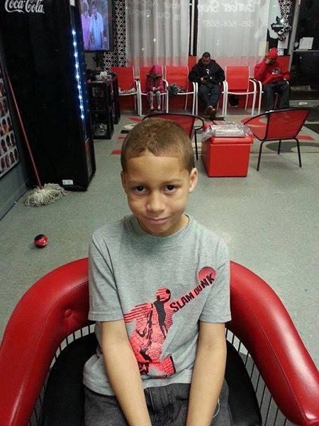 Boy Cuts Hair